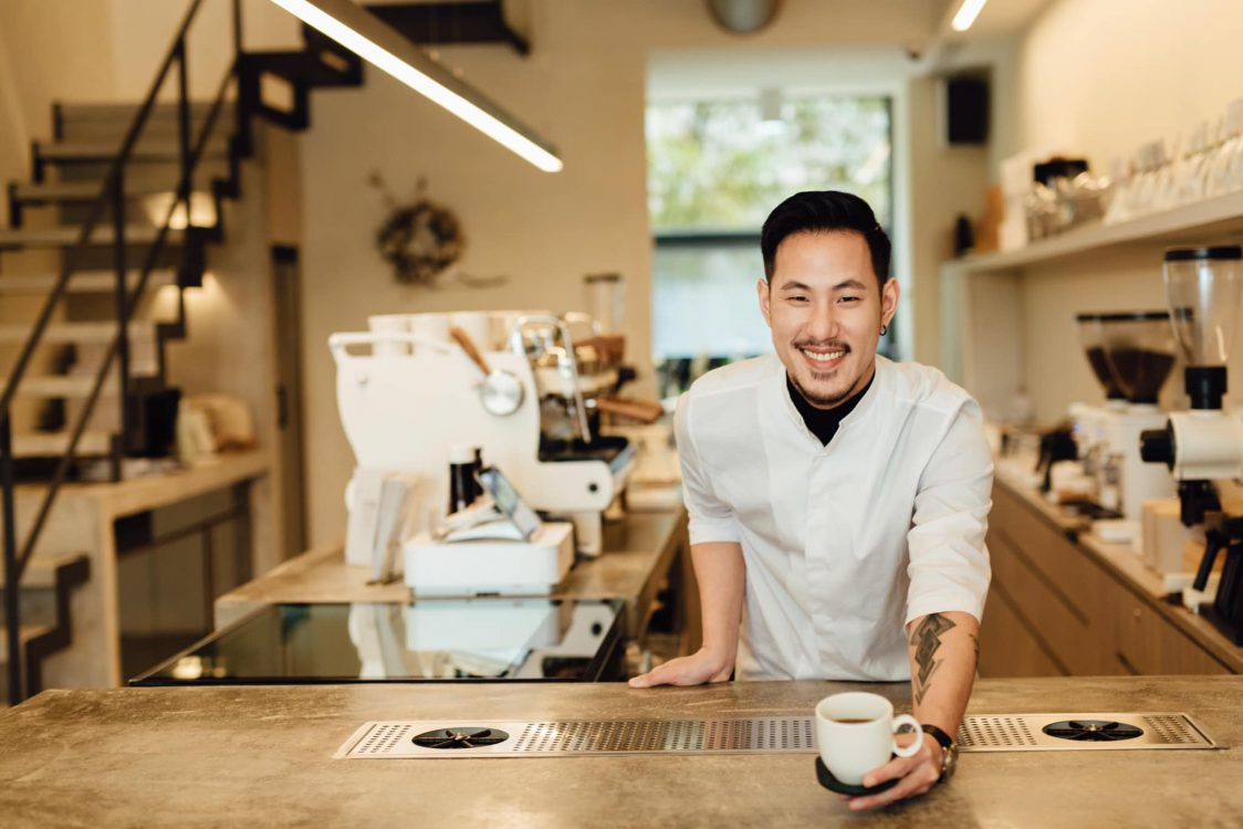 Chad Wang serving a brew coffee