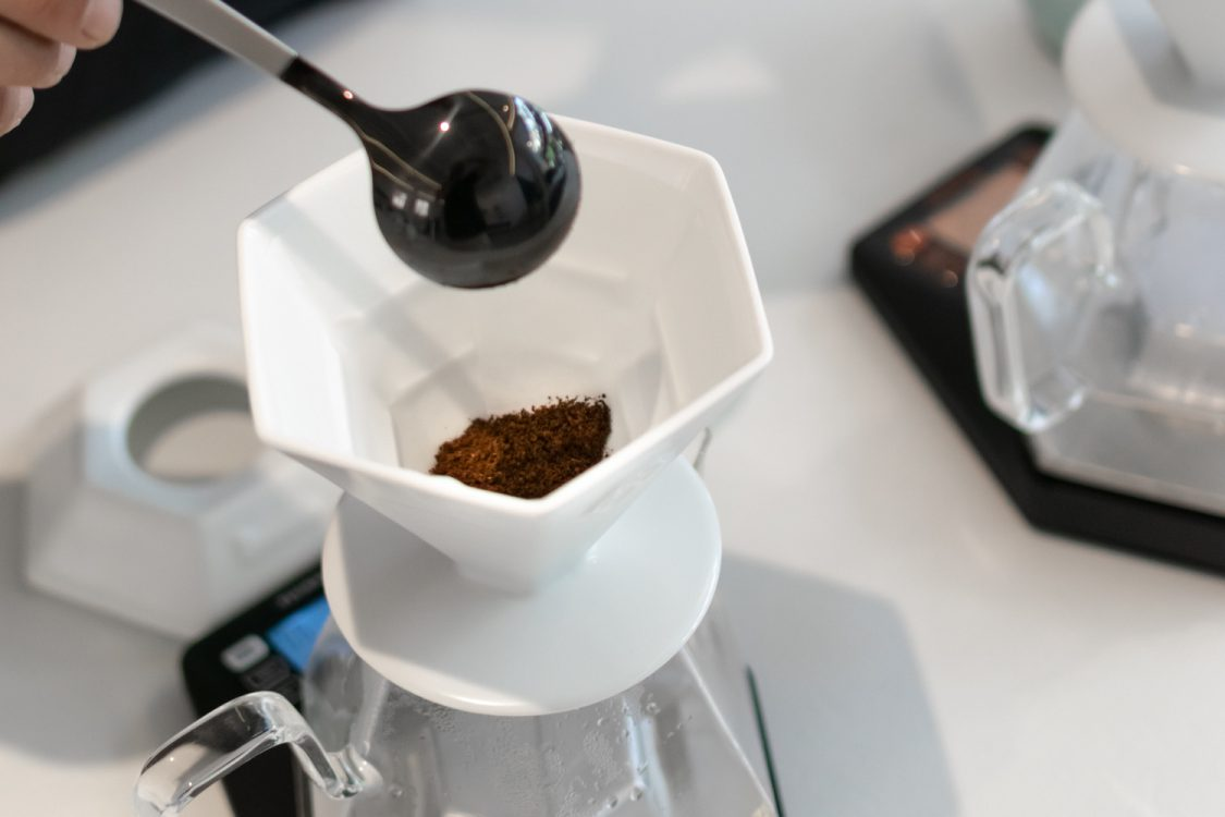 Ground coffee in a dripper