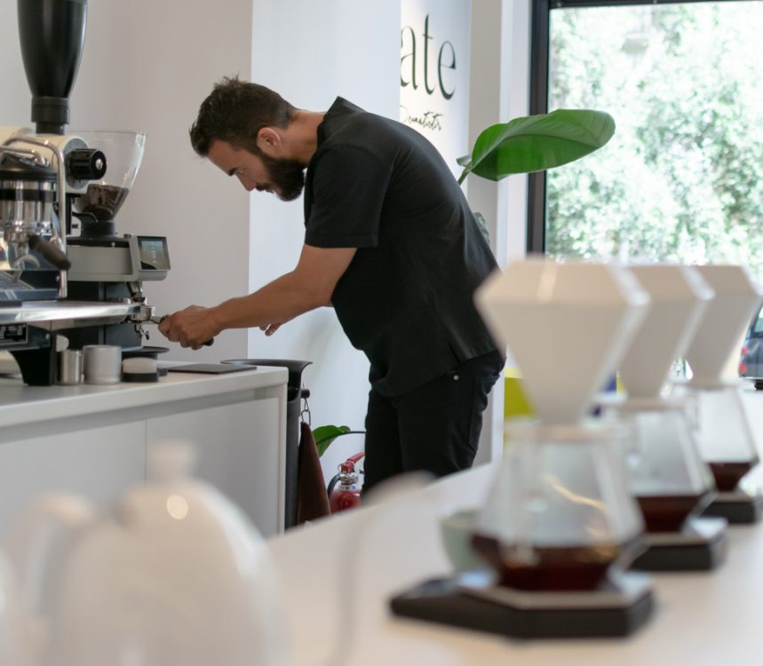 Stefanos is using a coffee grinder