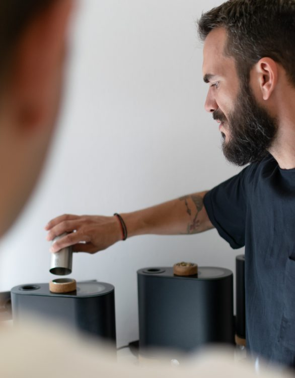 Stefanos Domatiotis is teaching candidates how to roast coffee